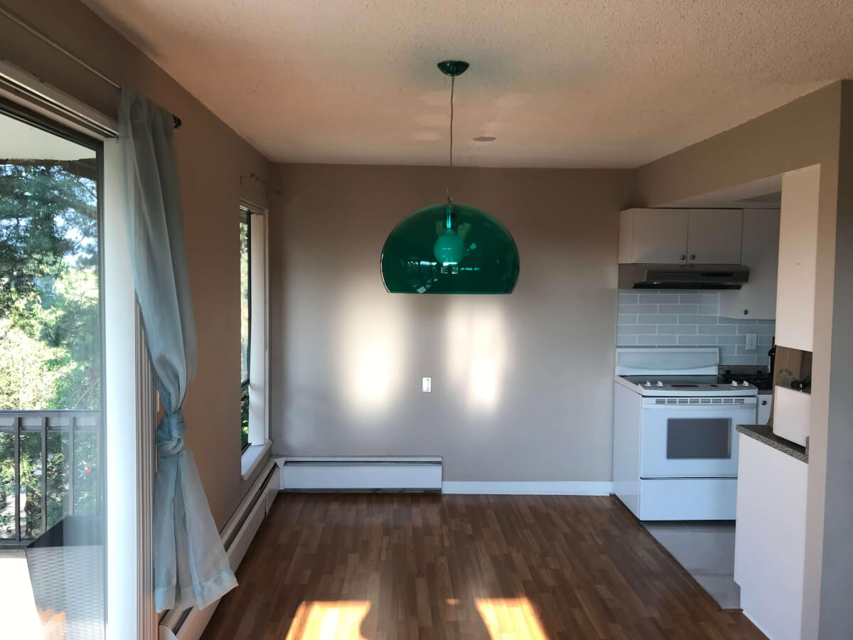 Photo of my dining area with low-hanging semi-transparent green lightshade.