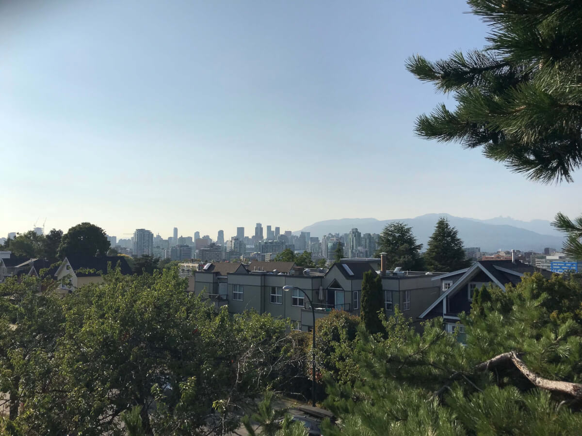 The view from my 3rd-floor balcony. Downtown Vancouver and the north shore mountains can be seen on a beautifully sunny and clear day.